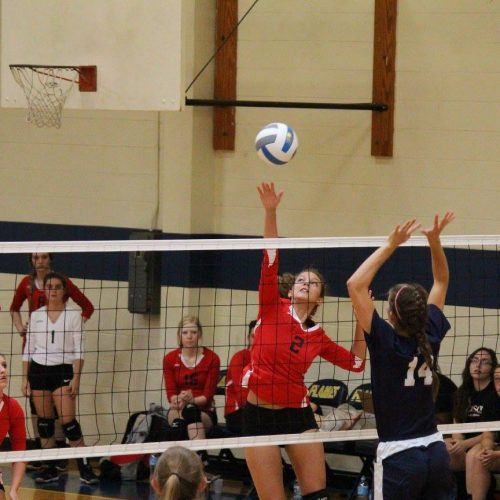 Judson college's Volleyball Team hitting a volleyball