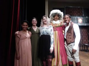 Freshman Natalie Pope poses with the cast of Sense and Sensibility, the ASC's final performance at Judson College.